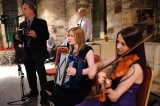 FiddlersWreck Ceilidh Band posing at the Hospitium